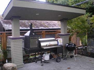 Open BBQ grilling area with a great roof and some spotlights
