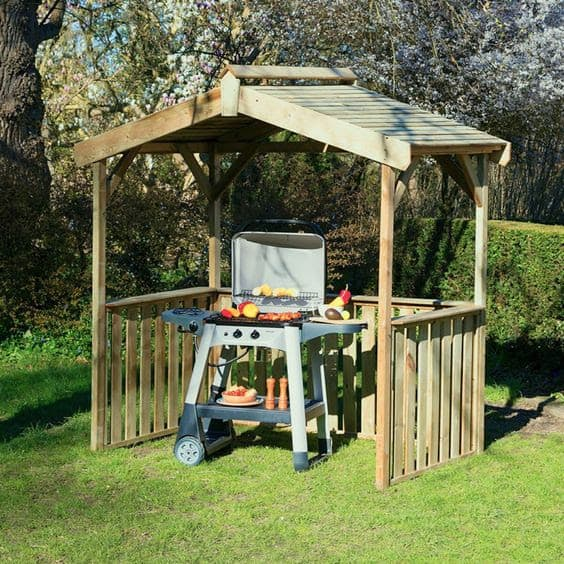 Small BBQ wooden shed that provides enough cover