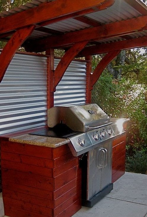 Red wood BBQ shelter with tin sheets