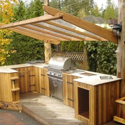 Wooden BBQ area with transparent roof