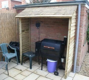Small corner BBQ shed installed on the wall