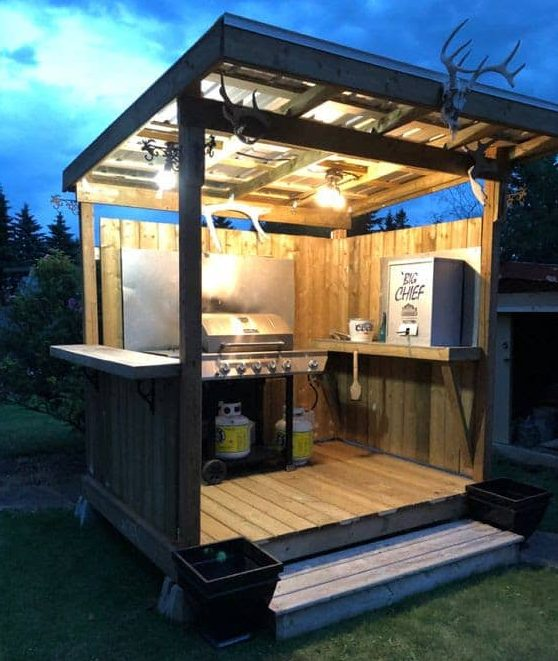 DIY wooden BBQ area with lights