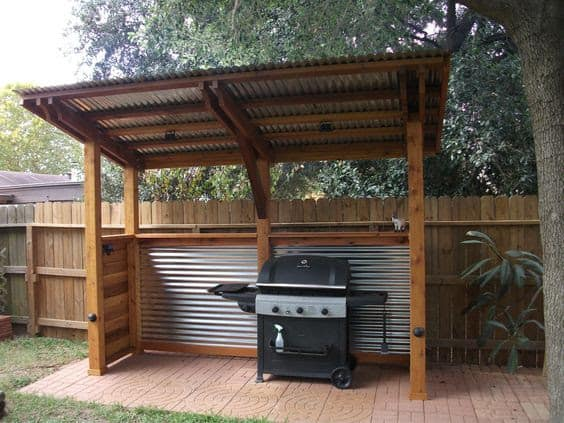 DIY BBQ shelter made from wooden and metal roof materials
