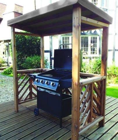 A tiny BBQ shelter that mimics a waiting shed, housing a gas BBQ grill