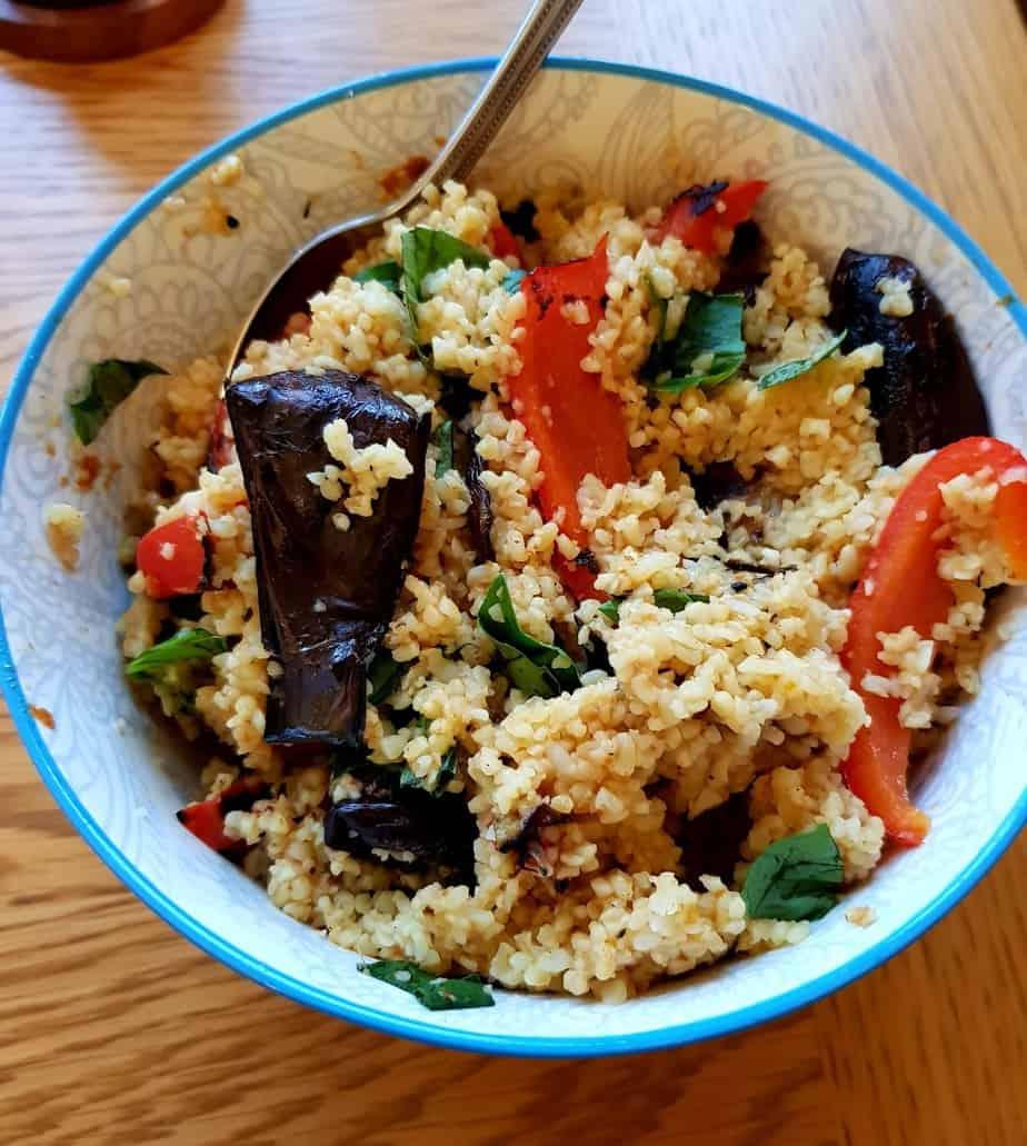 Charred aubergine, pepper and bulgur salad