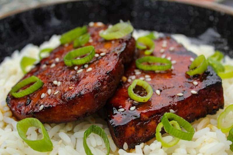 Grilled teriyaki tofu on top of a rice bowl