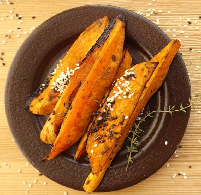 Grilled sweet potatoes sprinkled with sesame seeds