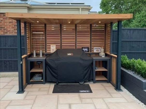 A garden BBQ area made of cedar wood with black finish metal frames