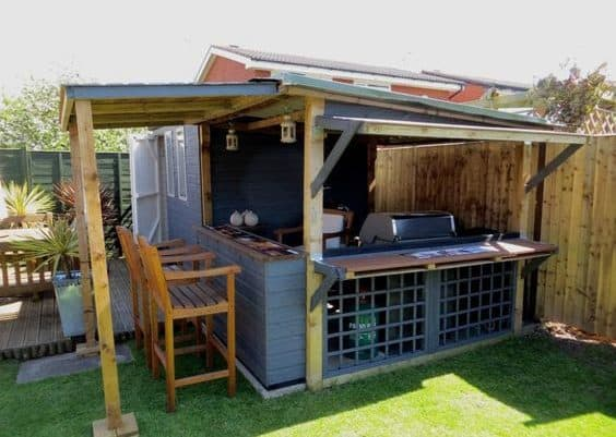 A garden BBQ set up in a shed building