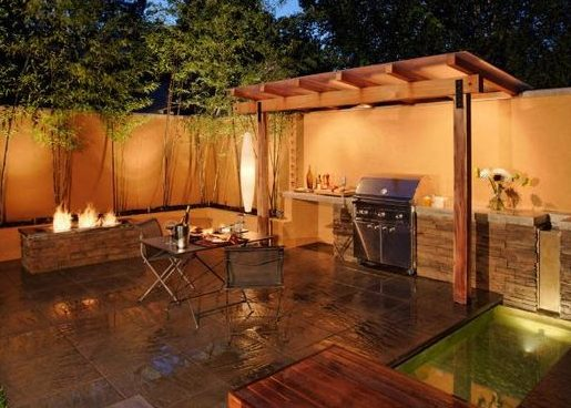 Backyard BBQ area with pergola above