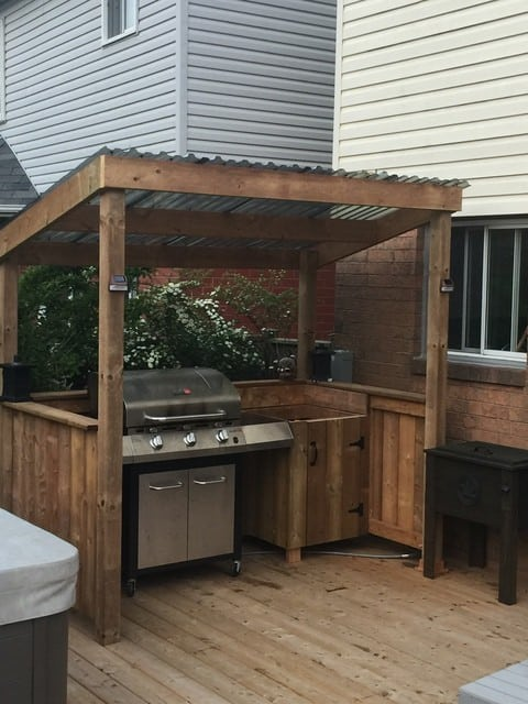 Small BBQ shelter with a small open shed for cover
