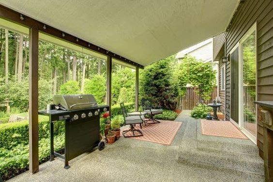 Huge backyard BBQ area with canopy