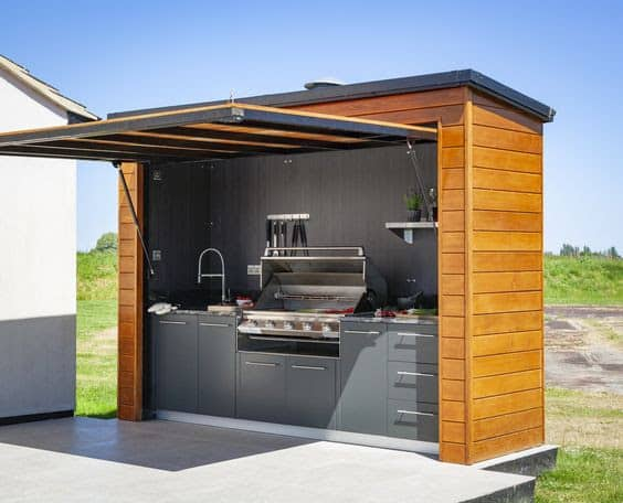 Bespoke outdoor kitchen shed with an opening door/canopy