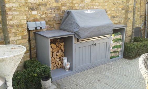 Simple grey BBQ area on wall