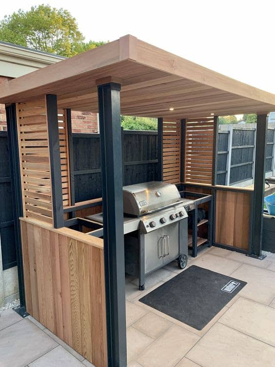 Enclosed wooden BBQ area in the poolside