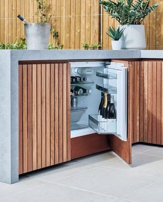 Small fridge in outdoor BBQ area