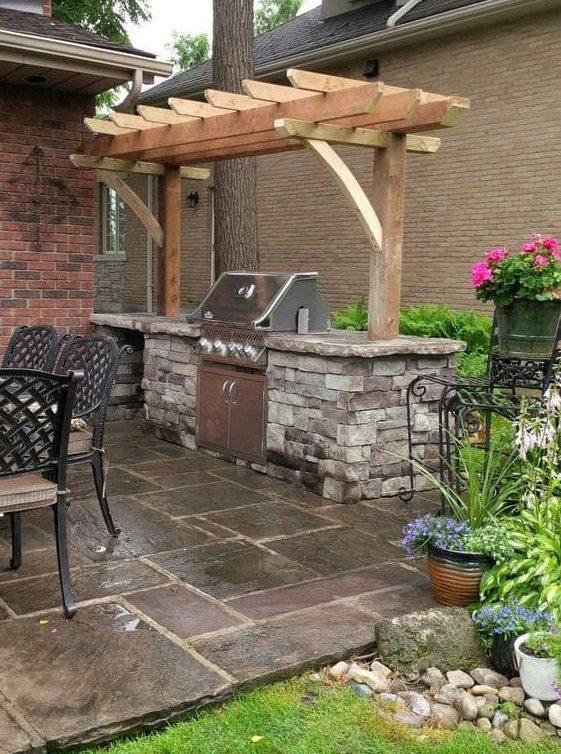 Stone BBQ area with pergola