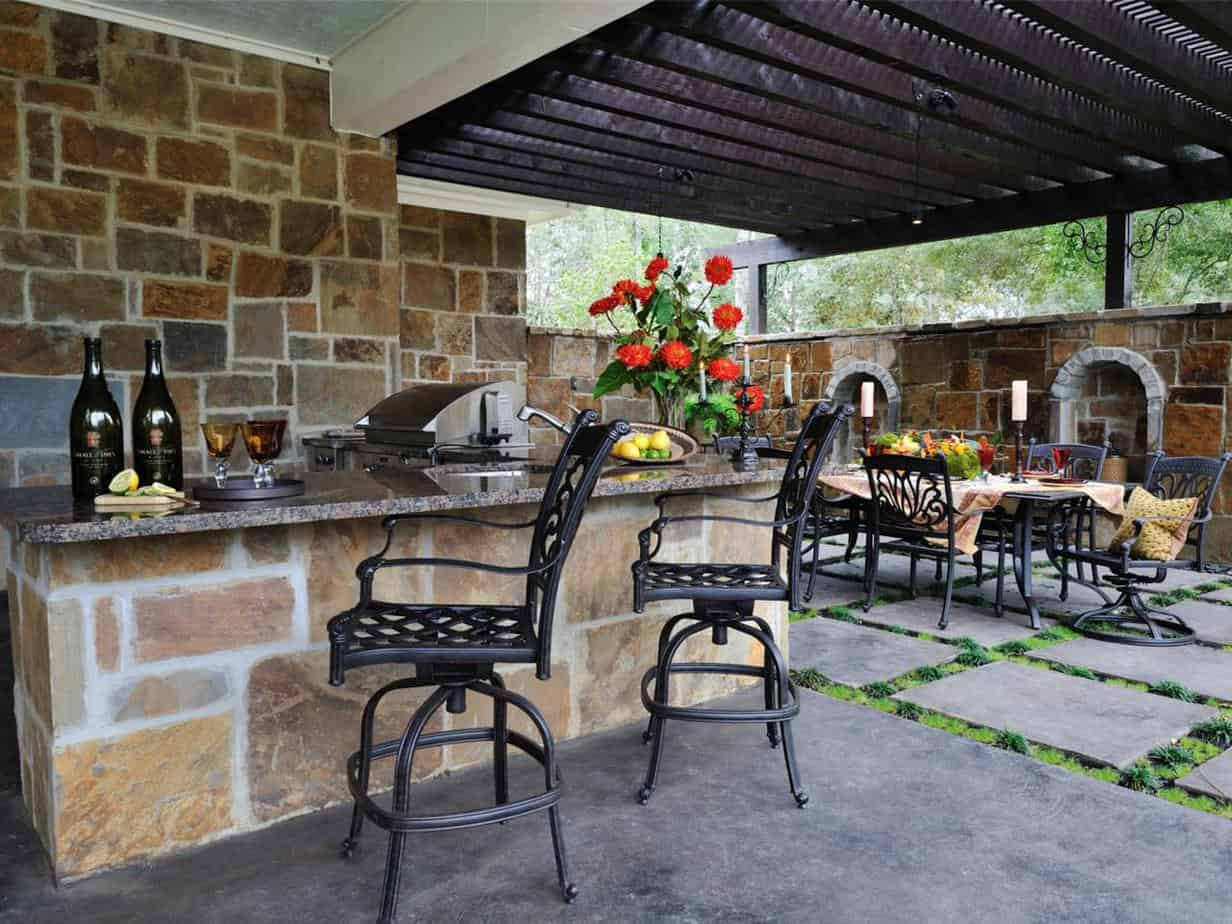 An outdoor bar area with BBQ station