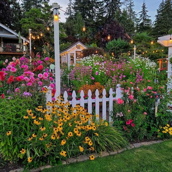 Roses, sunflowers, sweet peas and tulips planted in a front yard