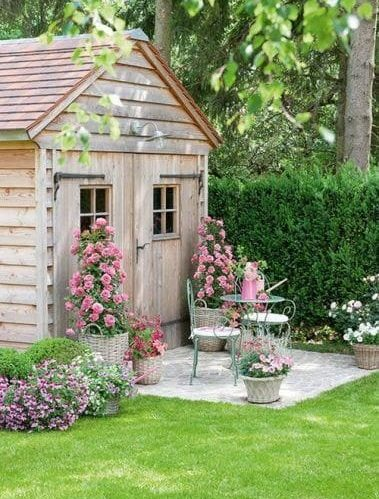 A cosy seating area outside a small shed