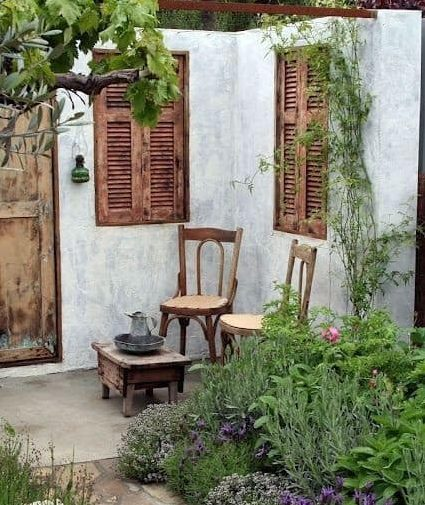 Backyard rustic corner with old chairs and shutters