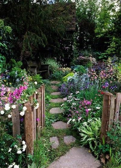 Cosy cottage with a stepping stones and colourful flowers
