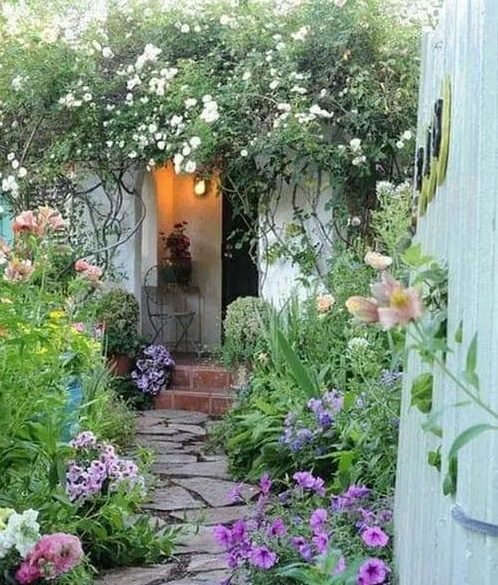 Small path and flowers at the side of a cottage garden