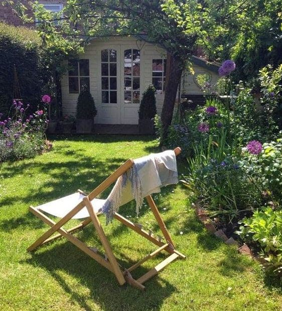 Relaxing backyard with a comfy chair and flowers