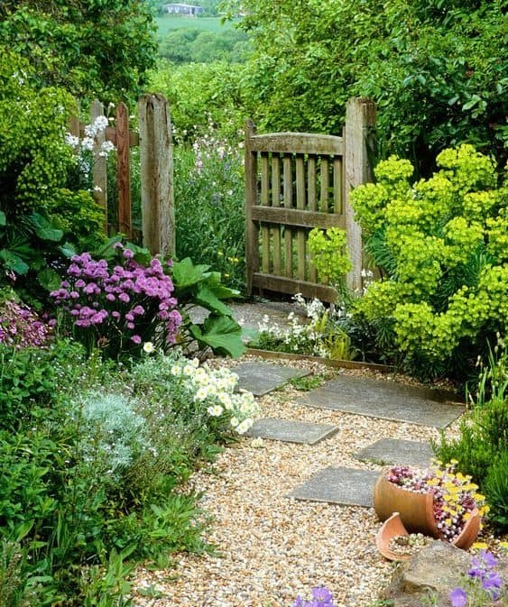Pebbles are placed near the gate creating a winding, more natural outdoor path