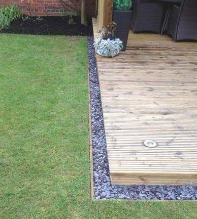 A small pebble border to a garden decking