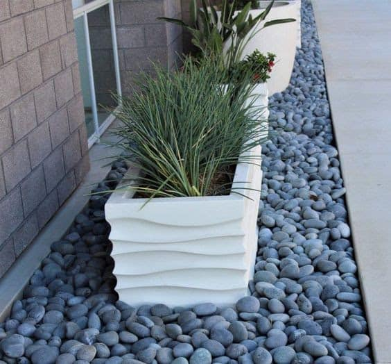 Planters on top of beach pebble base