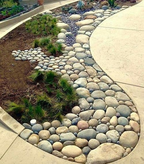 Pebble and stone garden bed