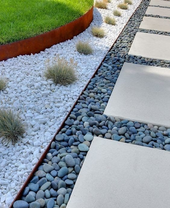 Garden walkway stepping stones with some pebbles