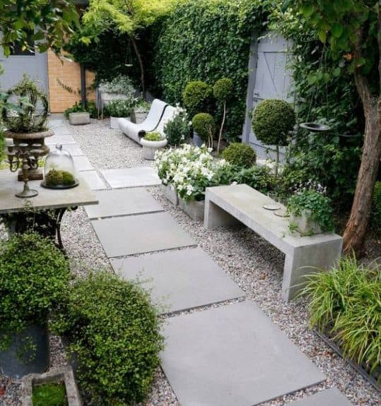 Grey stones that bring a contemporary feel to a backyard