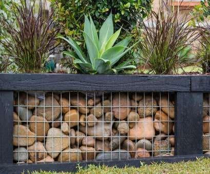 Enclosed pebble garden bed