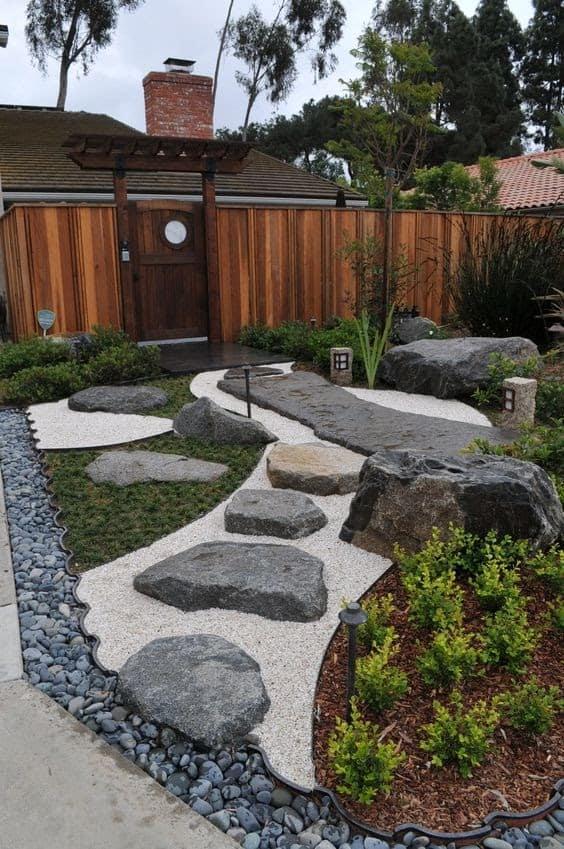 Pebbles, stones, and rocks that represent mountains in a zen garden