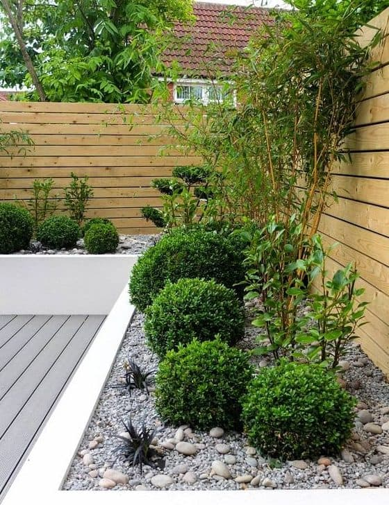 Garden bed decorated with pebbles and low-maintenance plants