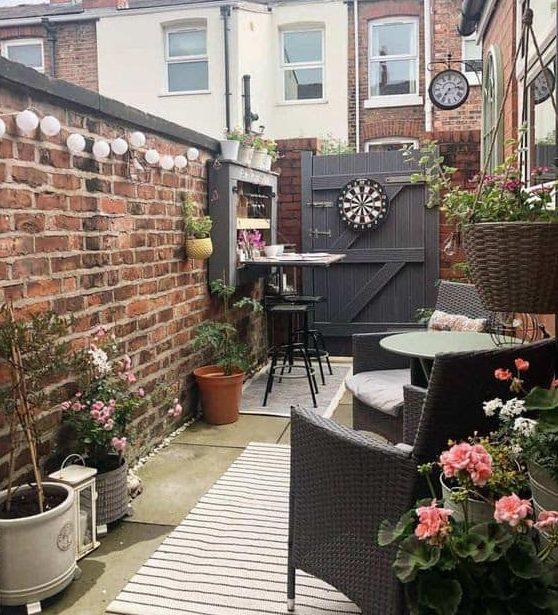 Small rectangular backyard with dark tone furniture and decors