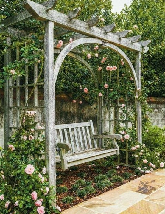 Rustic bench with pergola and flowers