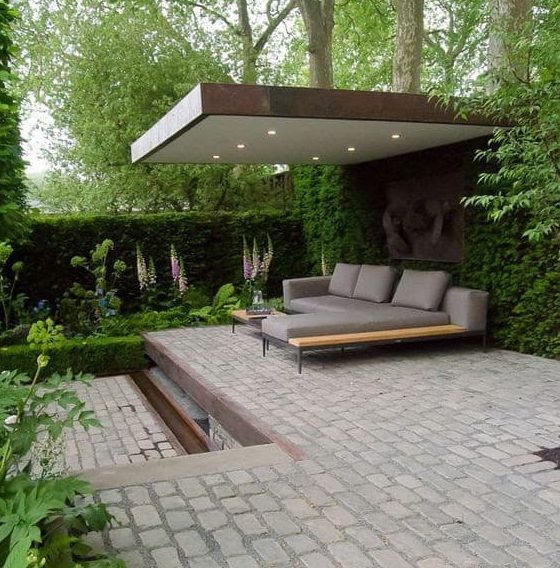 Bespoke garden resting spot with a solid roof to provide some shade