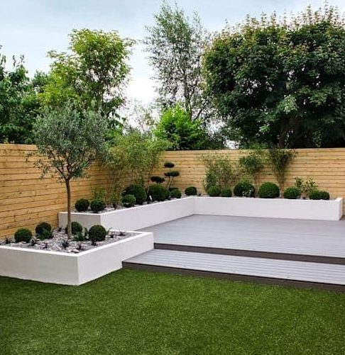 White deck and garden beds