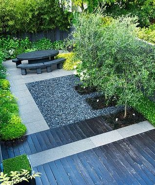 Dark wood deck and furniture for a modern garden look