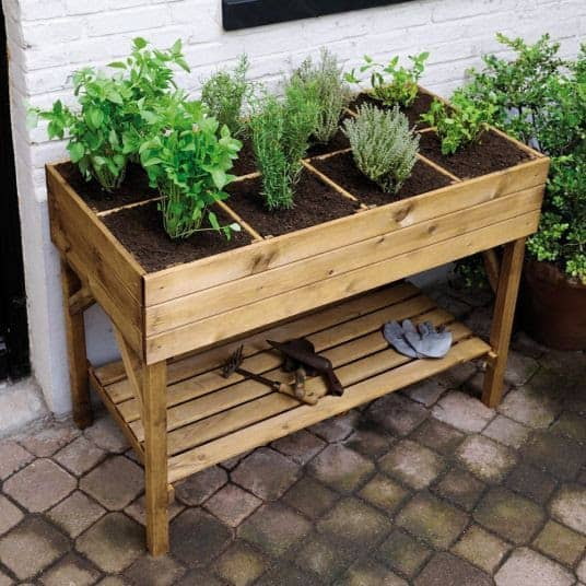 DIY raised garden bed with shelf and sections