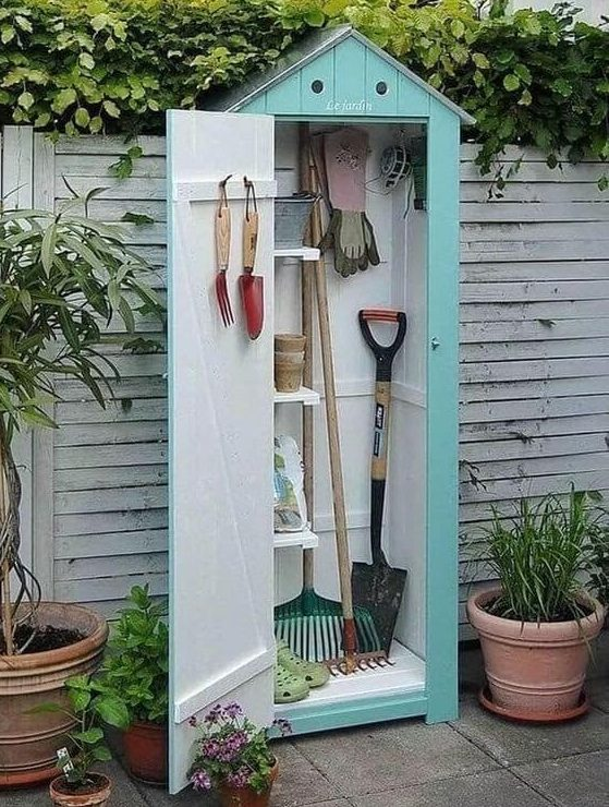 Cute small shed for storing garden tools and equipment
