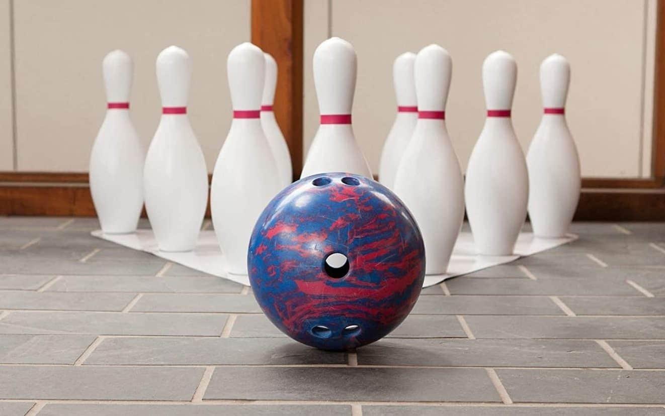 A bowling bowl and pins
