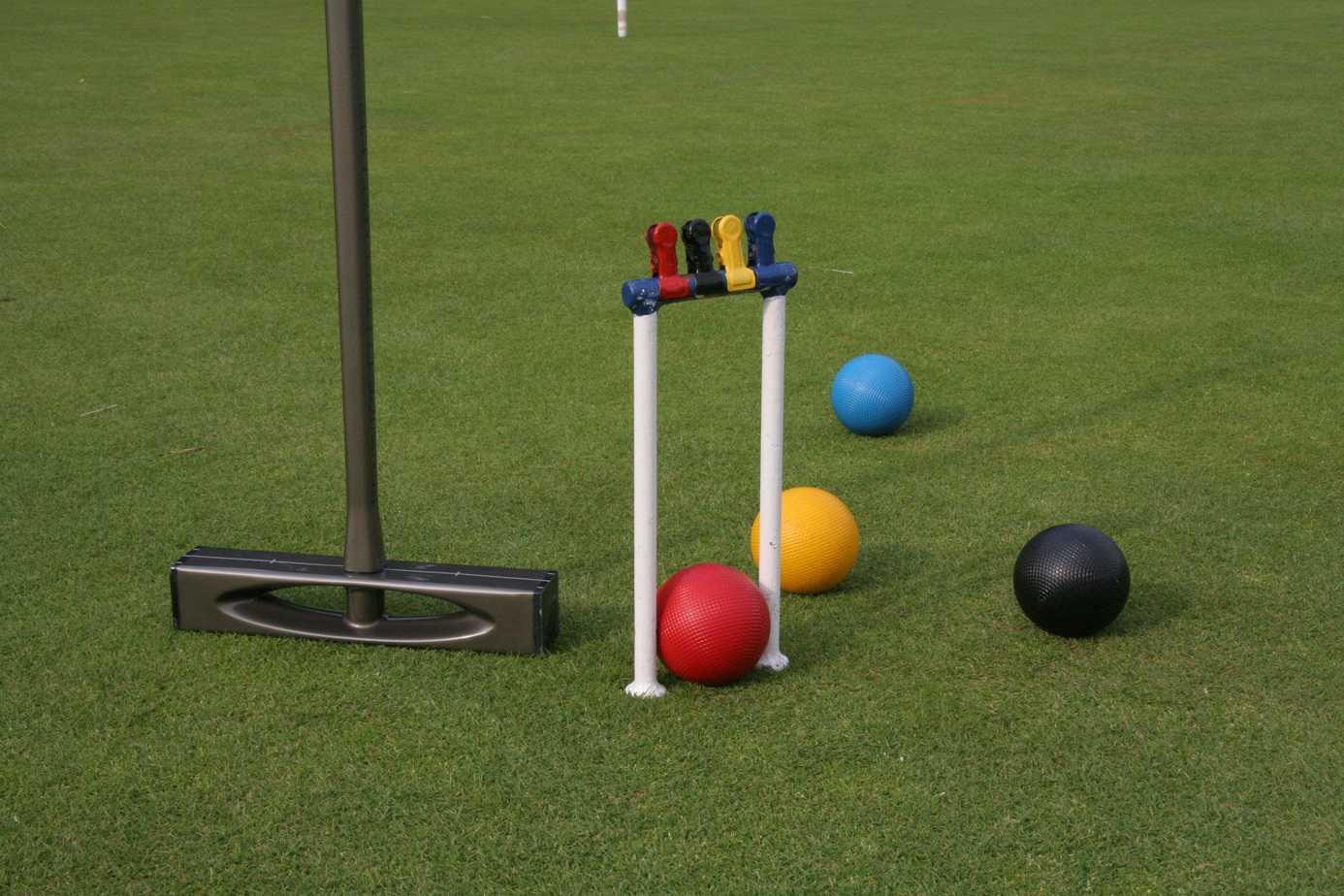 Croquet balls lying on a well-trimmed garden lawn