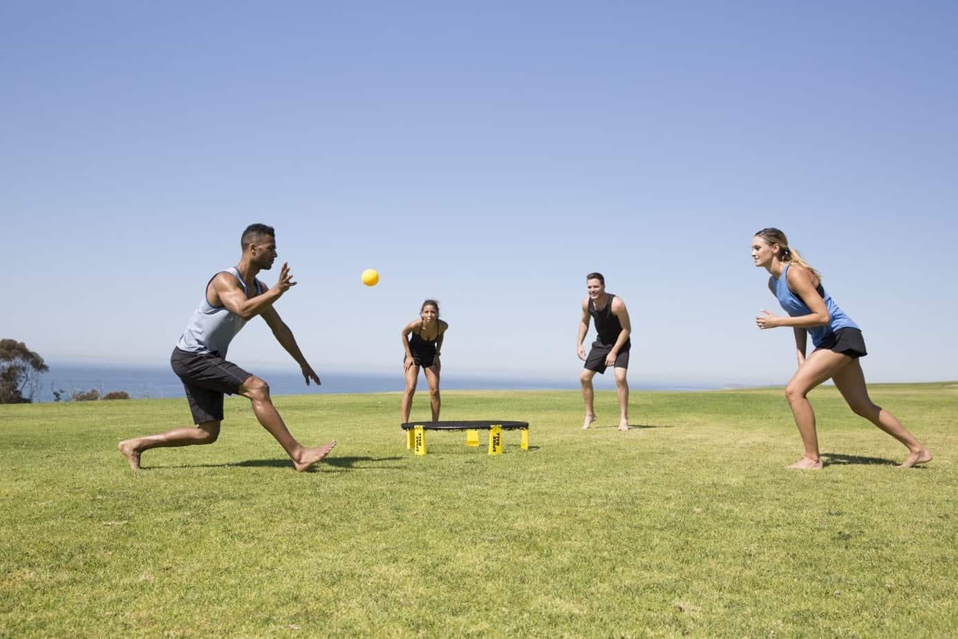 Teens playing spikeball game