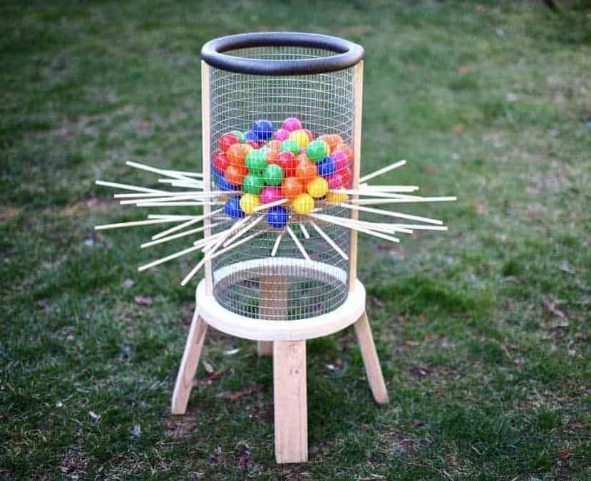 DIY giant kerplunk made of wooden and mesh materials