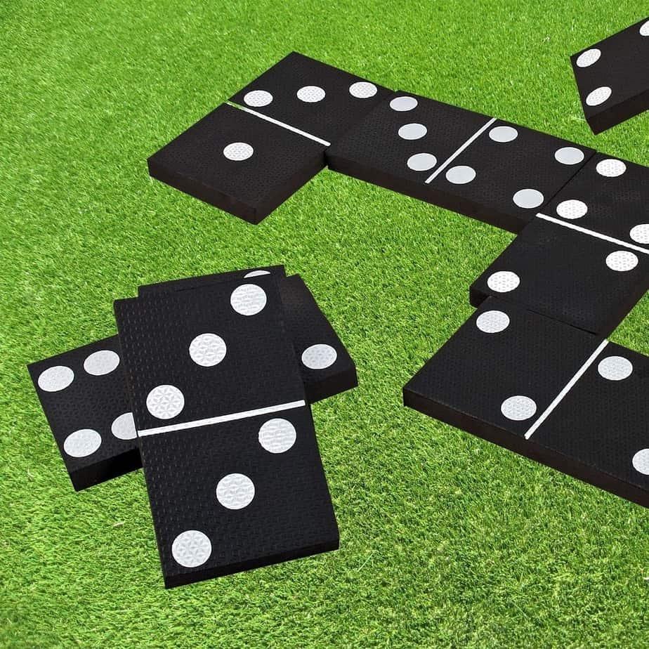 DIY giant dominoes lying on a garden lawn