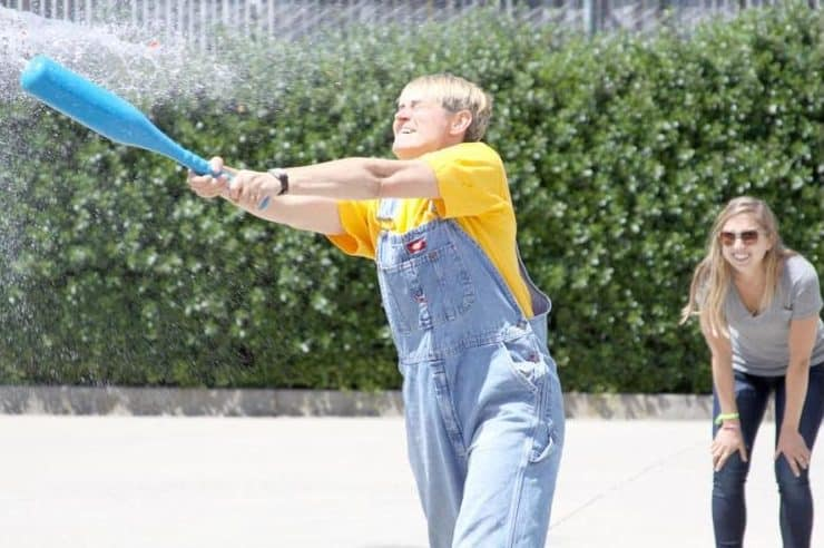 A player getting splashed during a water balloon fight